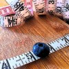 Measuring tape with blueberry